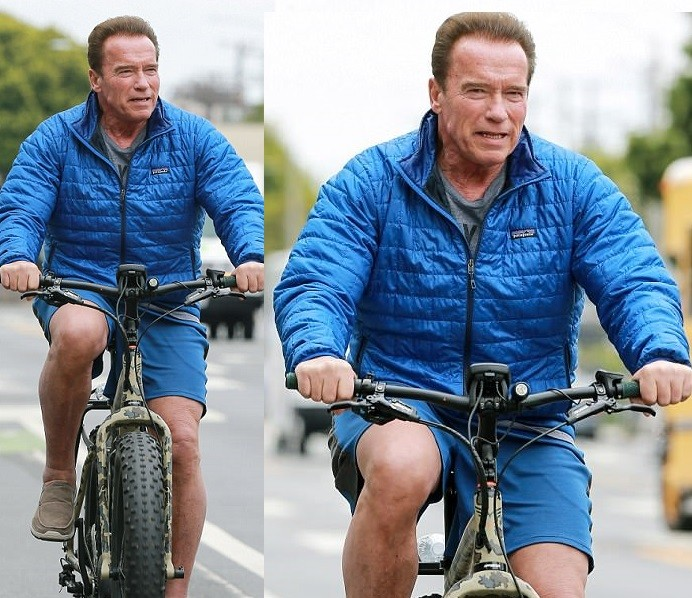 Happy man! Arnold Schwarzenegger is seen riding a bike in LA just two months after open-heart surgery