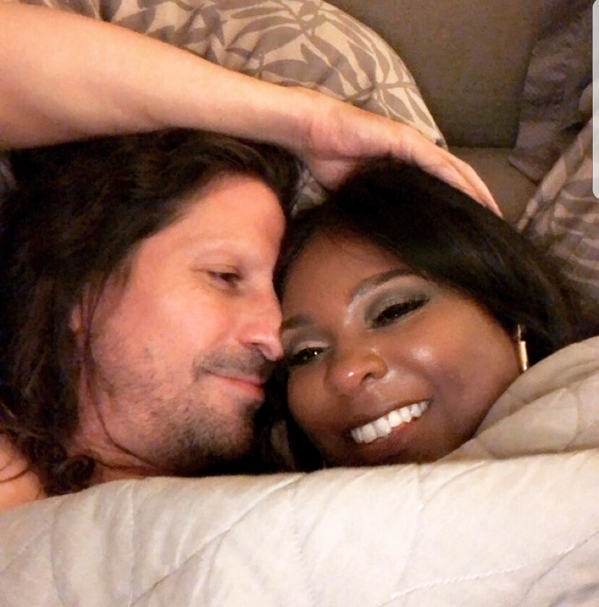 Kevin Hart 's ex-wife Torrei shares an intimate photo of herself in bed with a mystery white man.