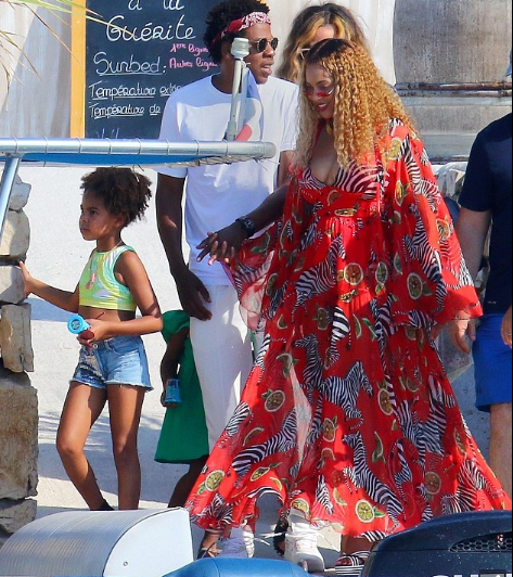 Beyonce hides her stomach in long dress as she steps out with Jay- Z and daughter Blue Ivy amid new pregnancy rumors (Photos)