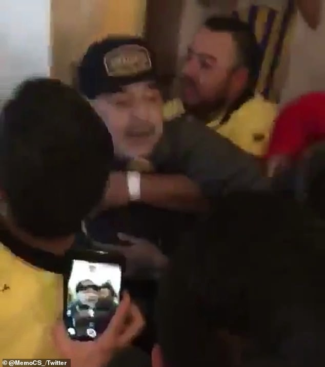Football legend Diego Maradona throws a punch at a reporter after his team lost