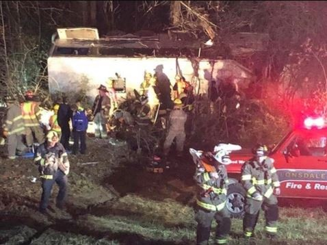 One dead and 40 others injured as bus carrying youth football team crashes in US