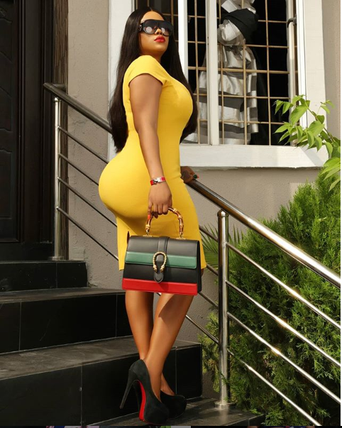Actress Daniella Okeke and her curves step out in a figure-hugging dress. (Photo)