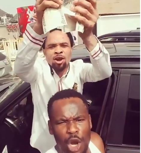 Viral Video of Pastor Odumeje showering Nollywood actor Zubby Michael with new naira notes