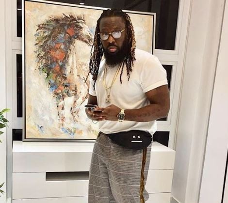 Photos: Timaya spoils himself with a brand new G-Wagon and a Maybach for Christmas