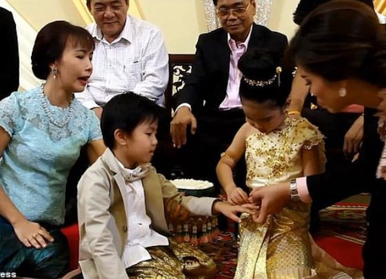 Six-year-old twins get married in a lavish Buddhist ceremony because their parents believe 'they were lovers in past lives' (Photos)