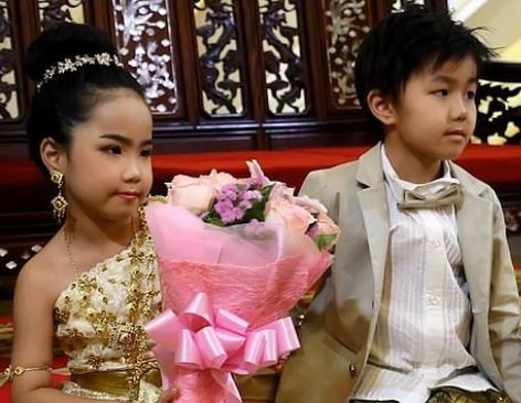 Six-year-oldtwins get married in a lavishBuddhist ceremony because their parents believe 'they were lovers in past lives' (Photos)