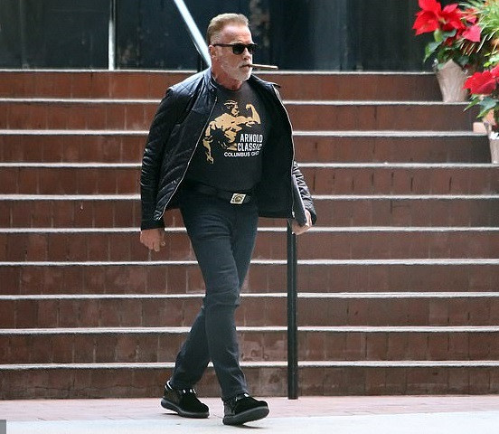 Veteran actor, Arnold Schwarzenegger steps out in style as he puffs on a thick cigar in LA (Photos)