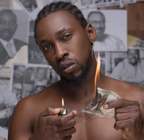 Orezi burns Nigerian currency in new photo