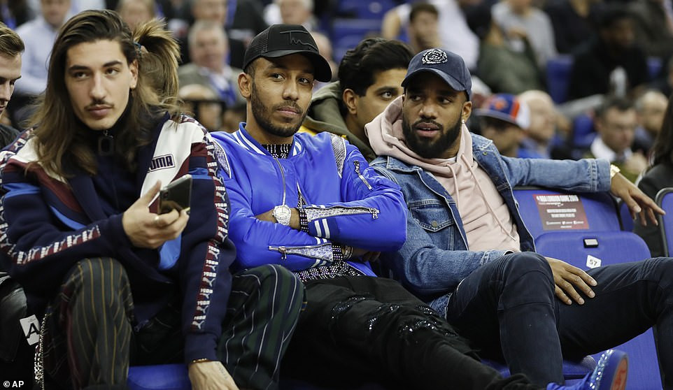 Arsenal and Chelsea football stars storm the O2 Arena in expensive designer wears to watch a basketball clash(Photos)