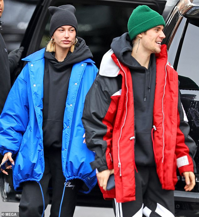 Justin Bieber and Hailey Baldwin are all smiles as they step out in NYC after 'postponing their wedding celebration for third time' (Photos)
