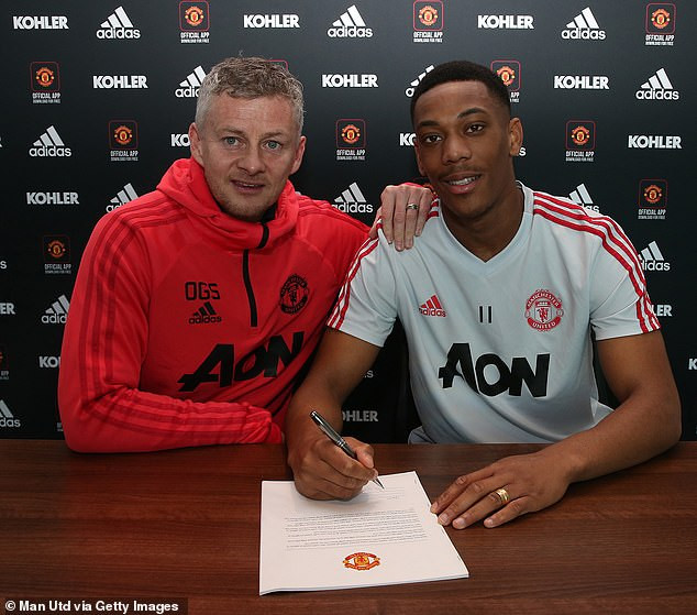 Anthony Martial commits his future to Man.U by signing new five-and-a-half-year contract worth 200,000 a week