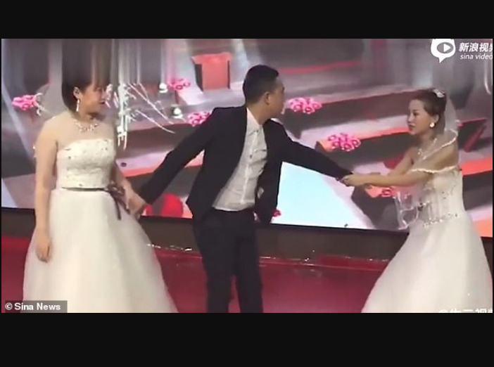 Watch the moment Groom's ex-girlfriend crashes his wedding wearing a bridal gown and begging him to come back to her.