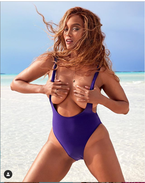 Tyra Banks grabs her boobs as she shares more racy photos from her Sports Illustrated Swimsuit edition cover.