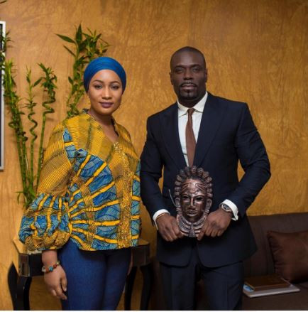 Jesu Segun London strikes a pose with Ghanas first lady as he shows off his latest collection (Photos)