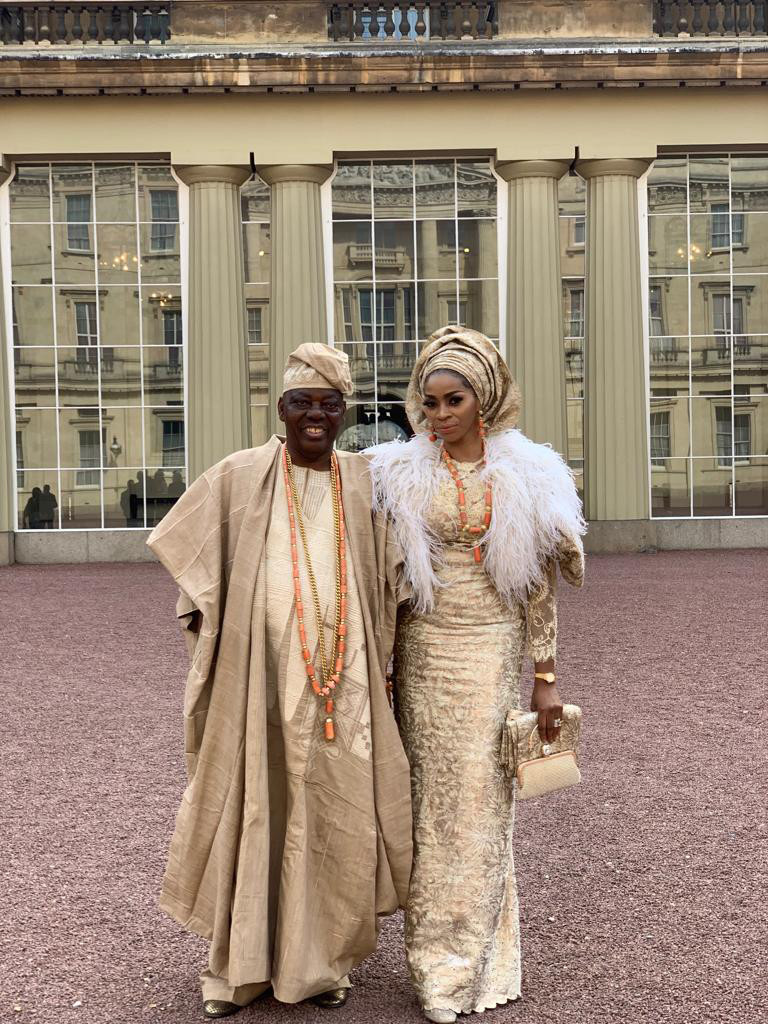 Chief Rasak Okoya and Wife Shade Graces Queen Of England Party At Buckingham Palace