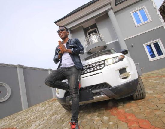 Juju musician, Mega 99 shows off his brand new Range Rover envoque