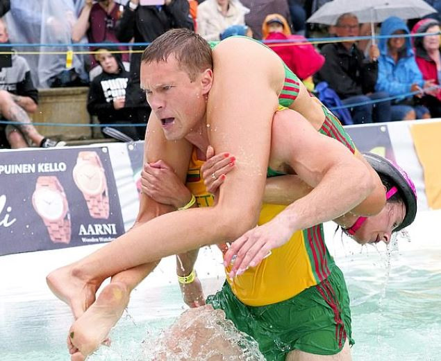 Photos from the 2019 World 'wife carrying' championship and you won't believe what the winniner smiles home with