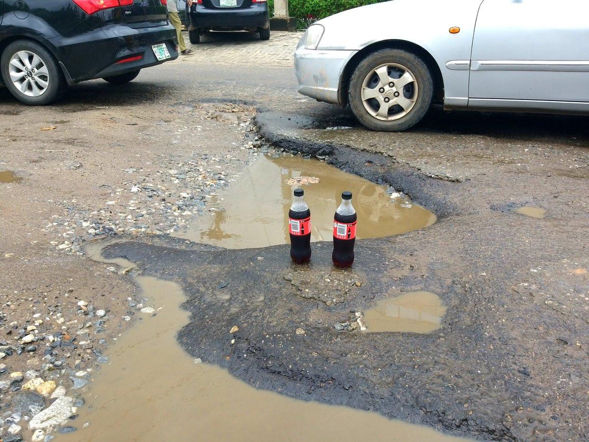 Nigerian lawyer celebrates potholes that keeps expanding with soda lindaikejisblog 2