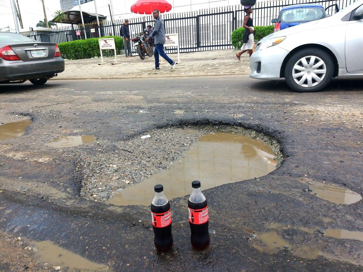 Nigerian lawyer celebrates potholes that keeps expanding with soda lindaikejisblog