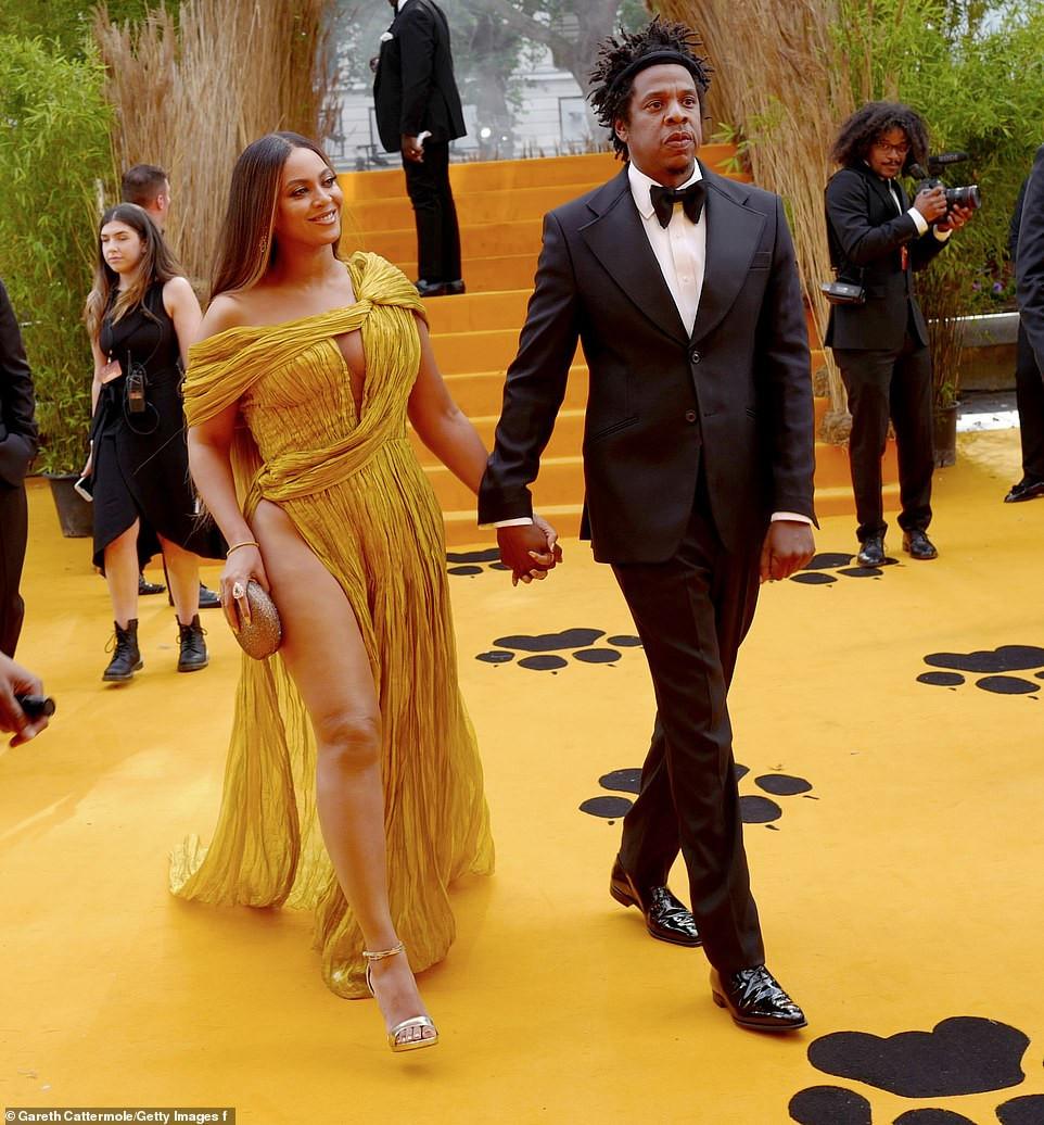 Beyonc commands attention in a gold asymmetric gown as she joins husband Jay-Z at London's premiere of The Lion King (Photos)