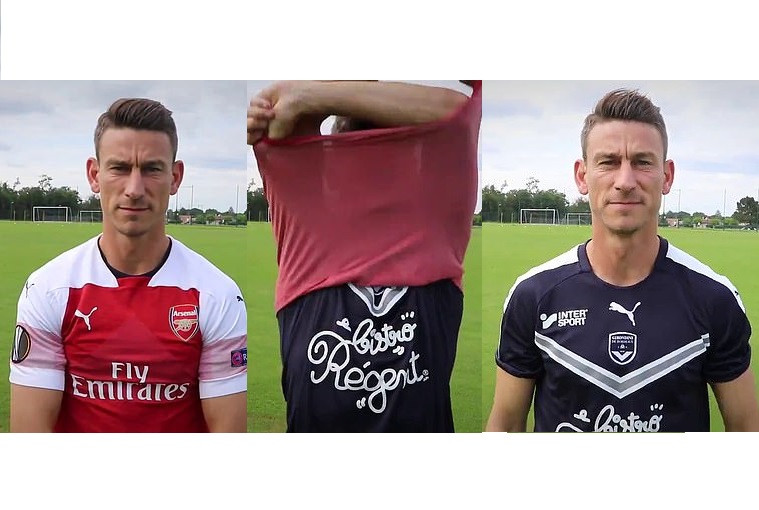 Ex-Arsenal captain Koscielny disrespects club by taking off red shirt to reveal Bordeaux jersey during his unveiling (Video)