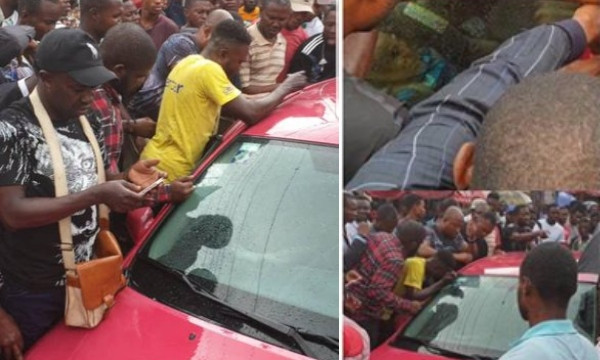 Baby gasping for air after being locked up in a car by his mum, rescued by traders in Lagos lindaikejisblog