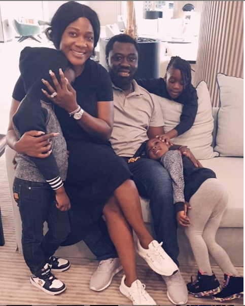 Beautiful family photo of Mercy Johnson, her husband, and their children