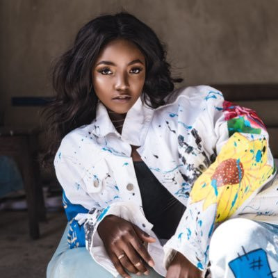 """F*** off"" Simi comes to her husband's defence by slamming follower who said he never listens to his music"