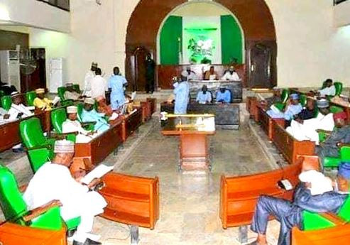 The Jigawa State House of Assembly has suspended two principal officers of the House for six months over interference with an investigation by the lawmakers.     Those suspended are the former Chief Whip of the House, Aminu Sule, and former Majority Leader, Sani Ishaq, both members of the All Progressives Congress (APC) representing Ringim and Gumel constituencies respectively.     Charmian of the House Committee on Information,Aminu Zakari, disclosed this to reporters on Tuesday at the end of plenary in the Dutse, the state capital.     According to him, both members allegedly attempted to confiscate some financial documents in the Ministry of Finance to prevent the committee set up by the House to investigate financial misappropriation between 2017 and 2018 perform its duties effectively.     When contacted, the former Majority Leader denied the allegation, stressing that it was not honourable for a member of the House to engage in such activities. Sule and Ishag were impeached along with the former Speaker of the House, Mr Isah Idris, in May 2019.