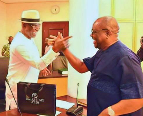 Caption this new photo ofMinister of State for Petroleum, Timipre Sylva and Rivers State Governor, Nyesom Wike