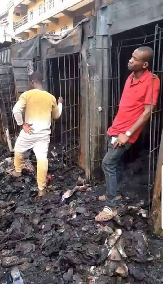 Sad photo of another young man standing dejectedly outside his shop razed in Onitsha tanker explosion
