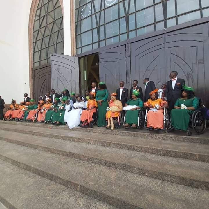 Nigerian lady in wheelchair weds her husband in Abuja with a bridal train of ladies on wheelchair lindaikejisblog