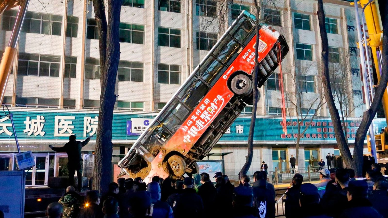 At least six dead as huge sinkhole swallows bus and pedestrian in China