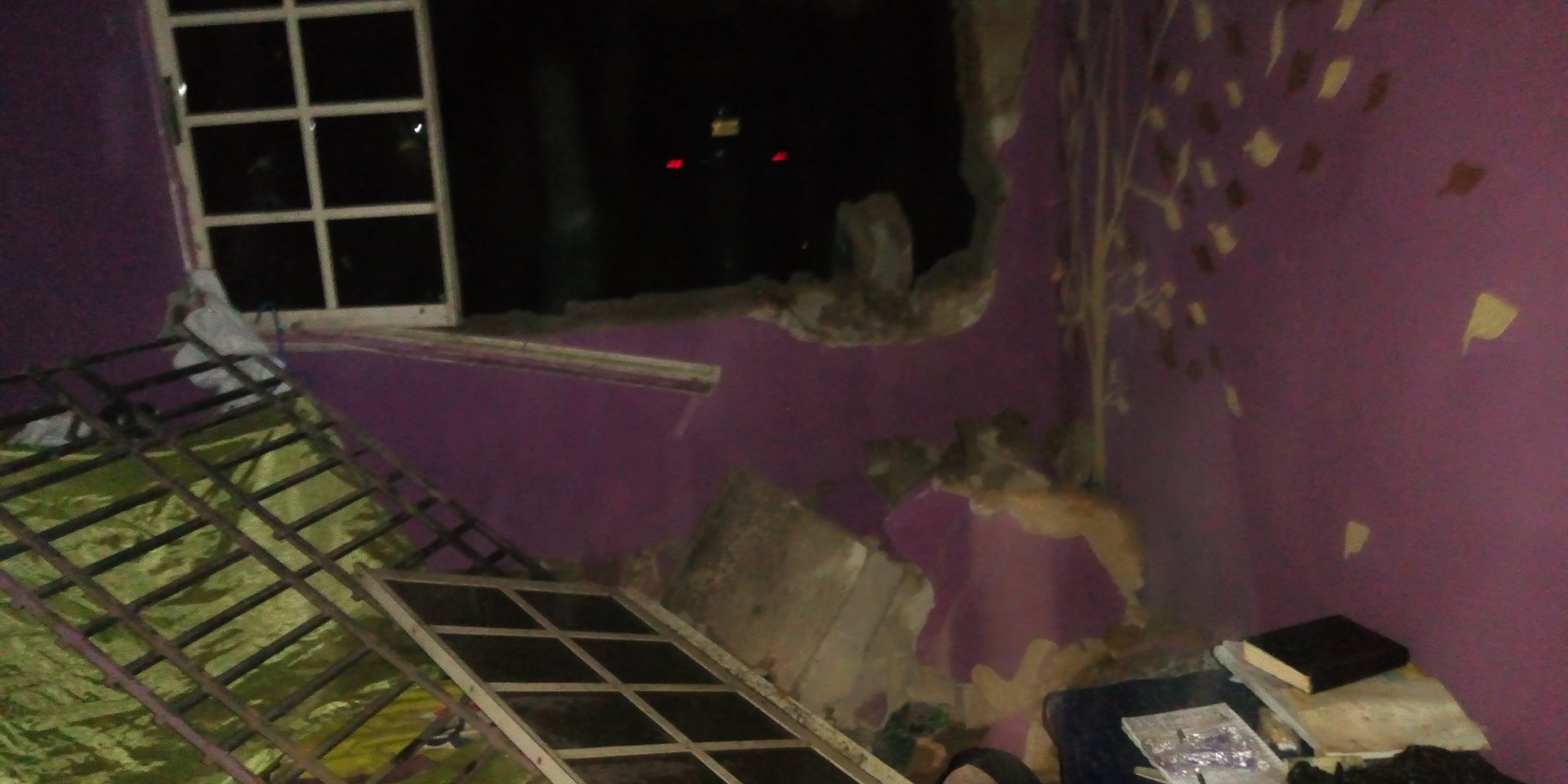 Woman escapes unharmed after heavy wind blew off her windows and wall at night, All9ja