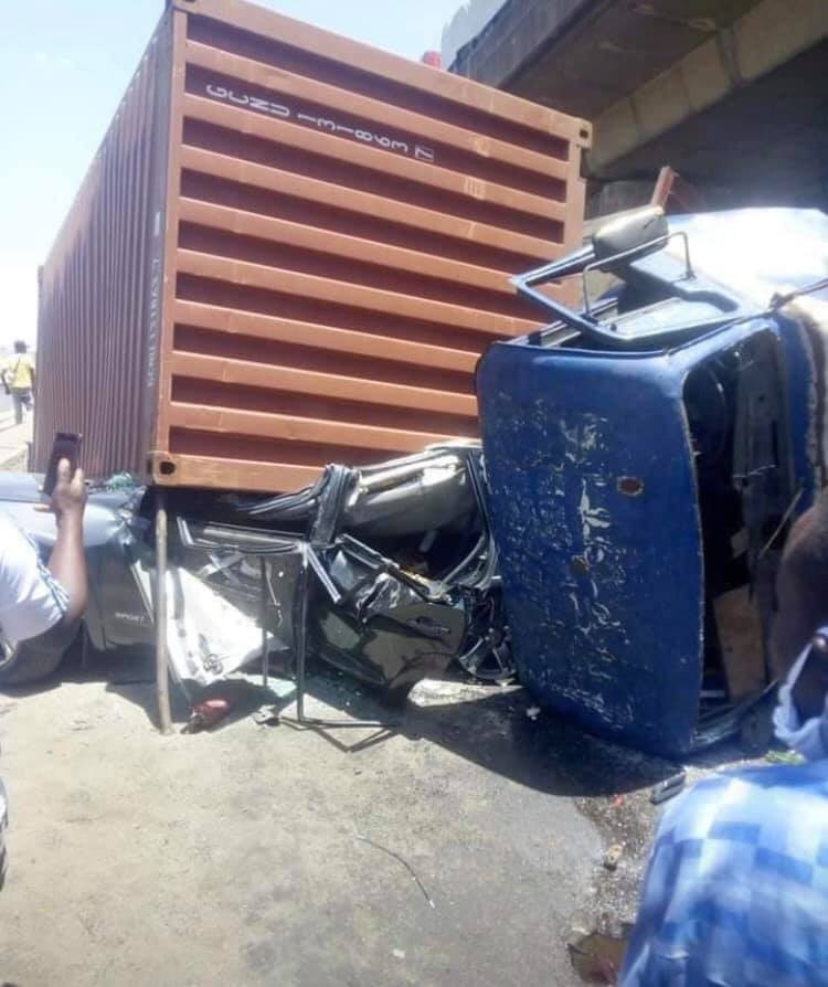 3 men walk away unscathed after a container fell on a car they were travelling in at Apapa lindaikejisblog 2
