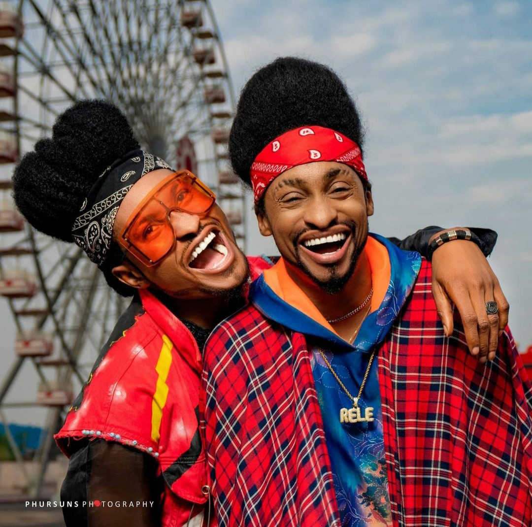 Denrele meets and poses with his doppelganger