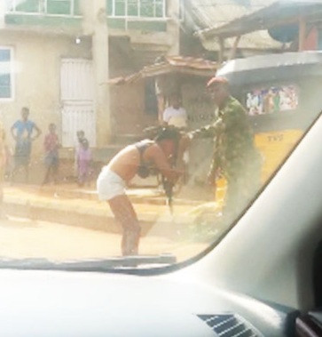 Soldier beats and strips lady naked for ''indecent dressing'' in Ogun (video)