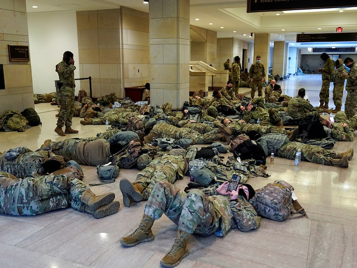 Exhausted US National Guards sleep on Capitol floor with their weapon by their side lindaikejisblog