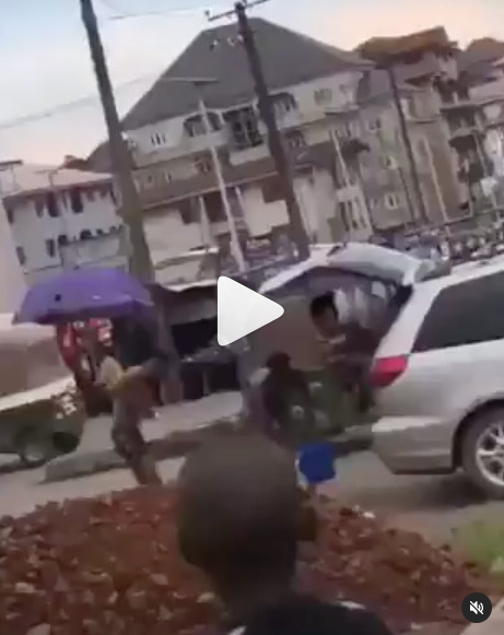 Suspected yahoo boys bath in the middle of the road as a native doctor performs ritual on them in Abia