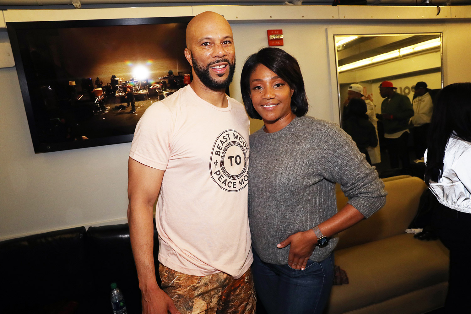 Actress Tiffany Haddish and boyfriend Common share a kiss in racy #silhouttechallenge video