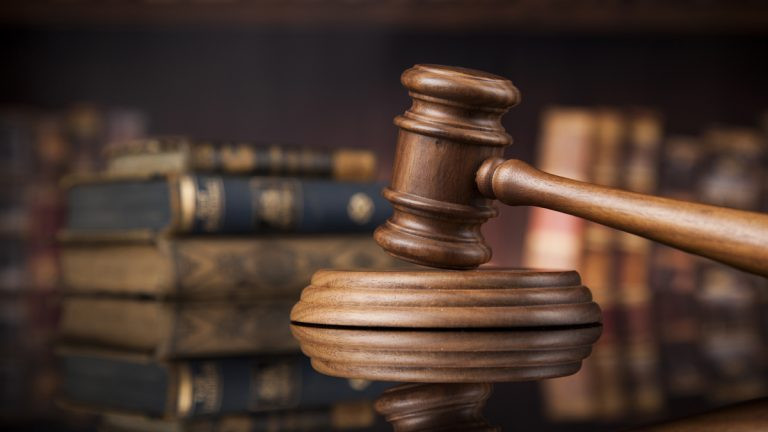 Former Governor's aide arraigned in court for calling ex-wife an adulterer