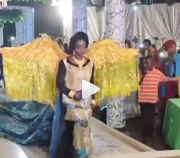 Northern bride shows up at her wedding in wings cape