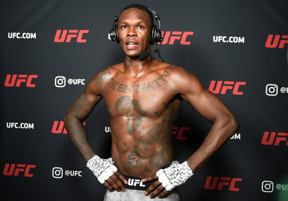 Israel Adesanya dropped by BMW after 'rape' comments to rival Kevin Holland