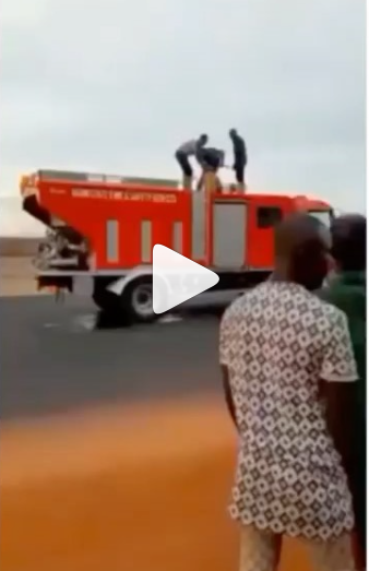 Firefighters seen filling jerrycans with water to put out a fire in Ogun state