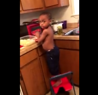 Adorable moment little boy argues with his mother because he wanted to cook for the family but she won