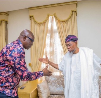 Image result for Aregbesola and fayose shaking hand