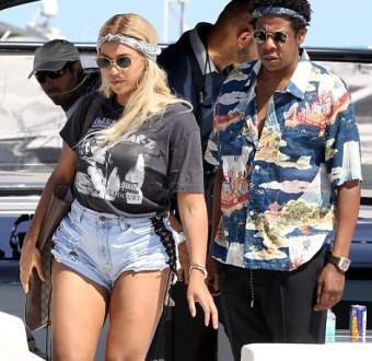 Beyonce conceals her stomach in baggy T-shirt amid pregnancy rumours as she relaxes on a yacht with Jay-Z