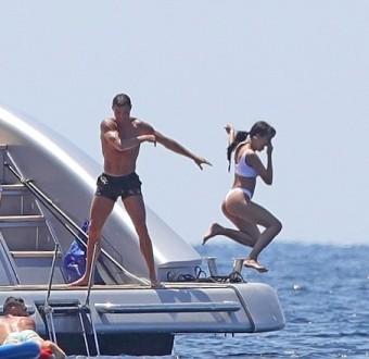 Cristiano Ronaldo throws bikini-clad girlfriend Georgina Rodriguez into the sea as they enjoy yacht trip in Ibiza (Photos)