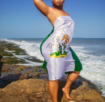 Nigerian lady uses Nigerian flag to cover her nakedness in sexy Independence photo shoot