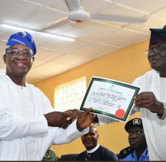 Photo: INEC presents certificate of return to Gboyega Oyetola as Osun State Governor-elect